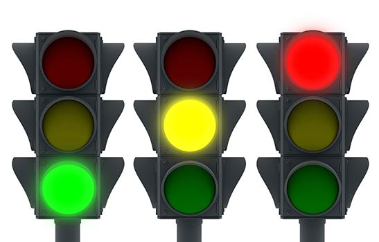 A graphic of three stop lights in a row, the first with the green glowing, the second with the yello