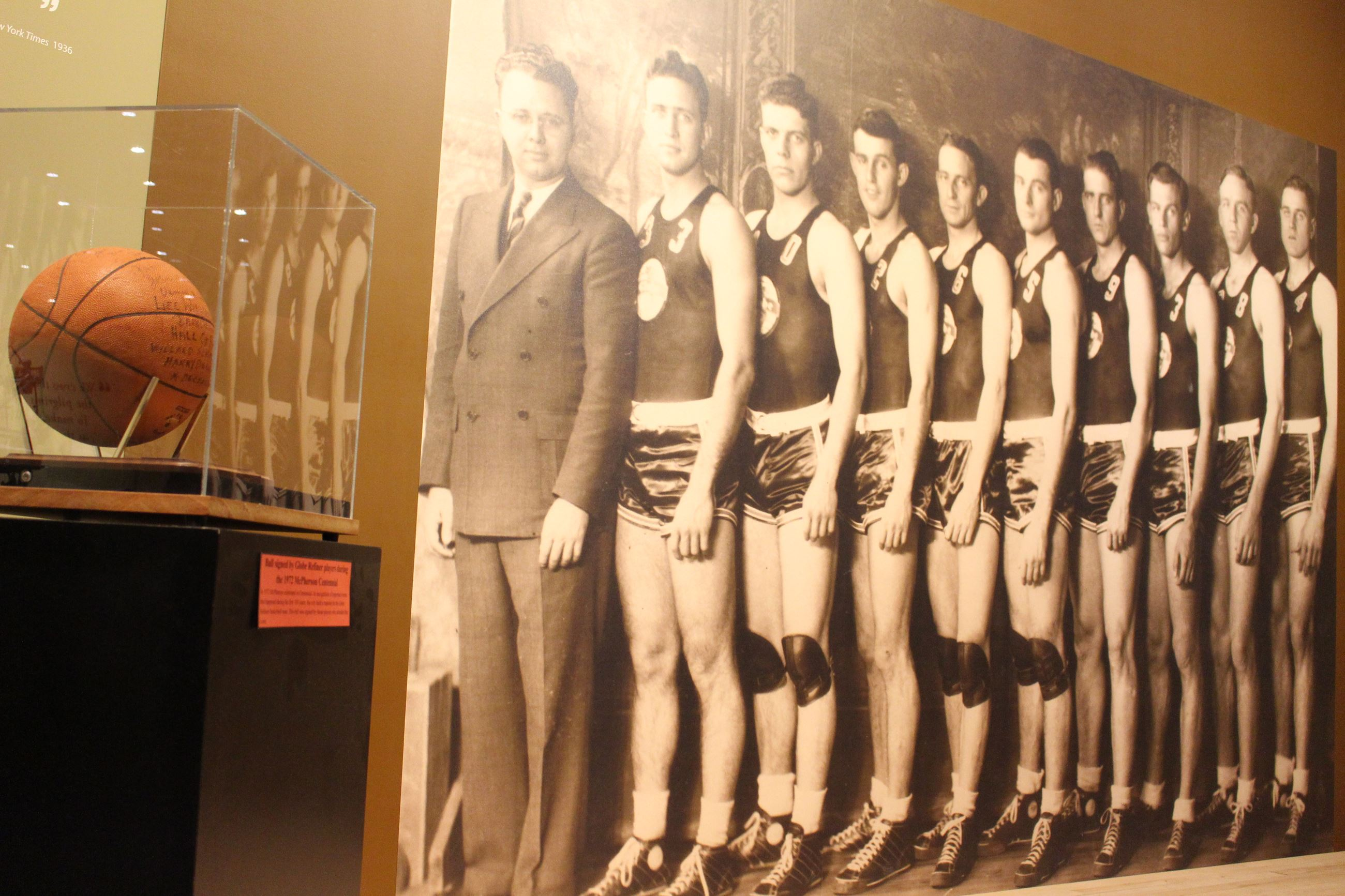 Life-size photo mural depicting 7 members of the 1936 Olympic Basketball Team with a signed basketba