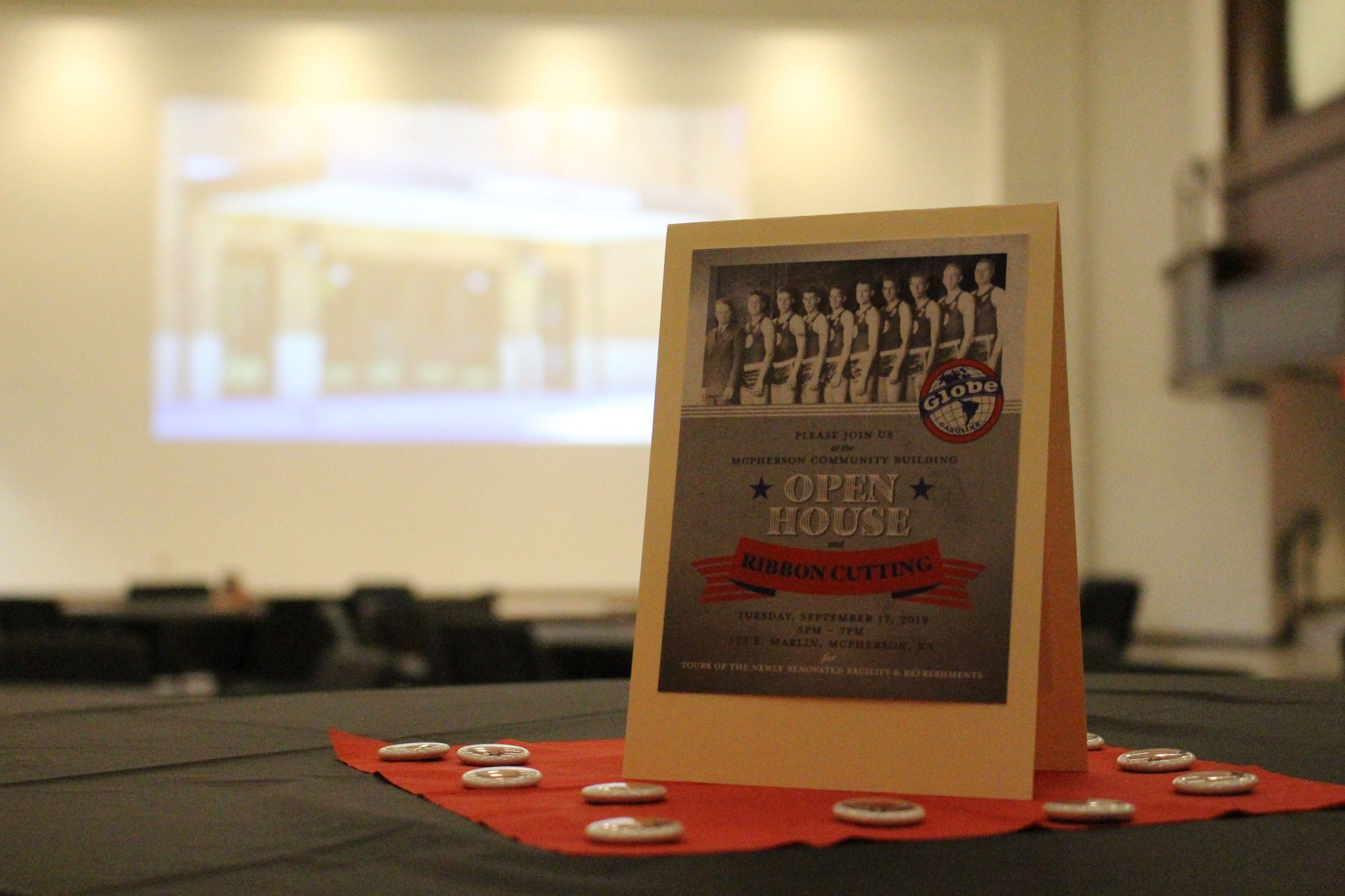 Table decoration featuring the McPherson Globe Refiners basketball team used for the community build