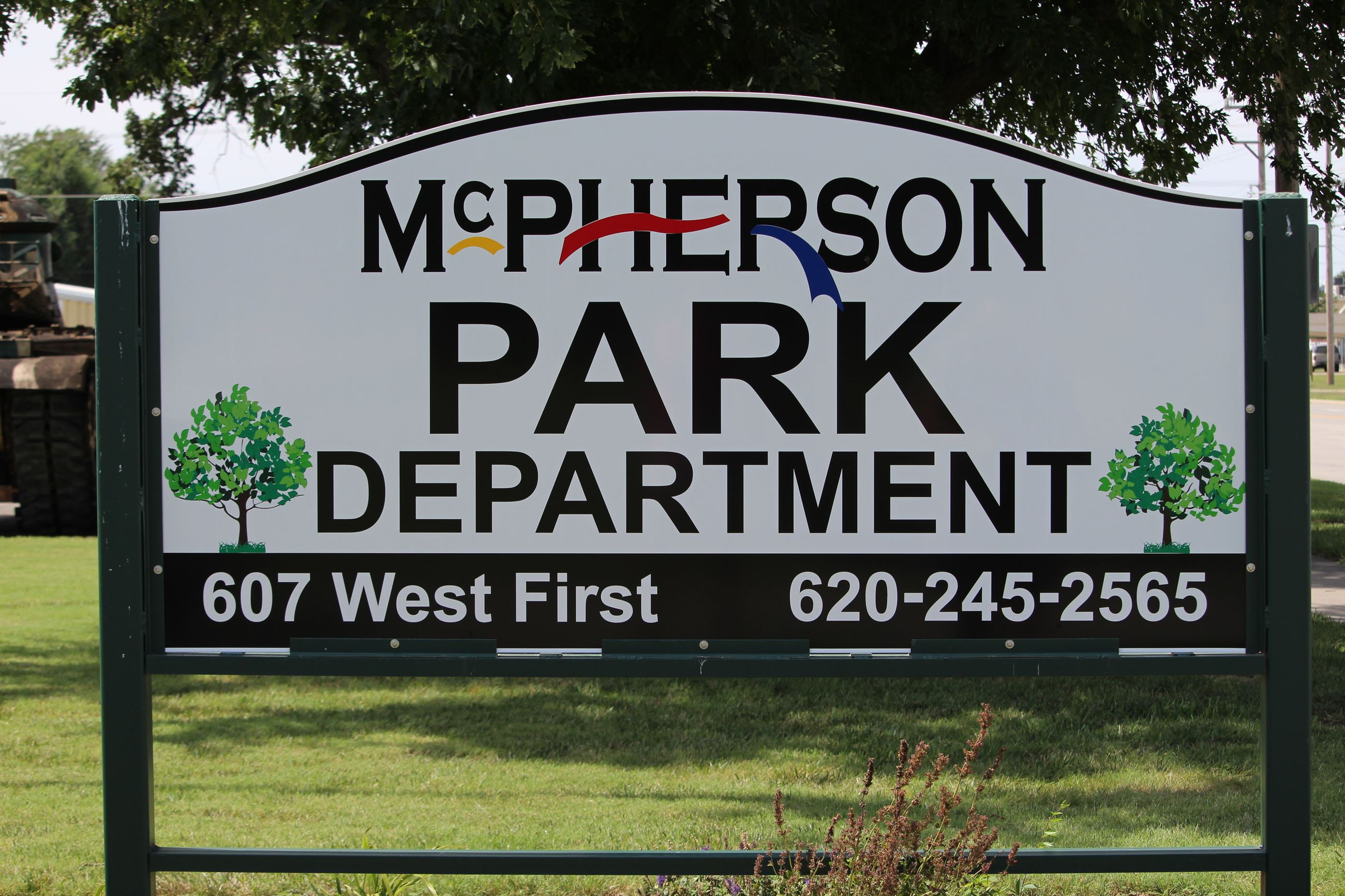 An outdoor sign identifying the McPherson Park Department