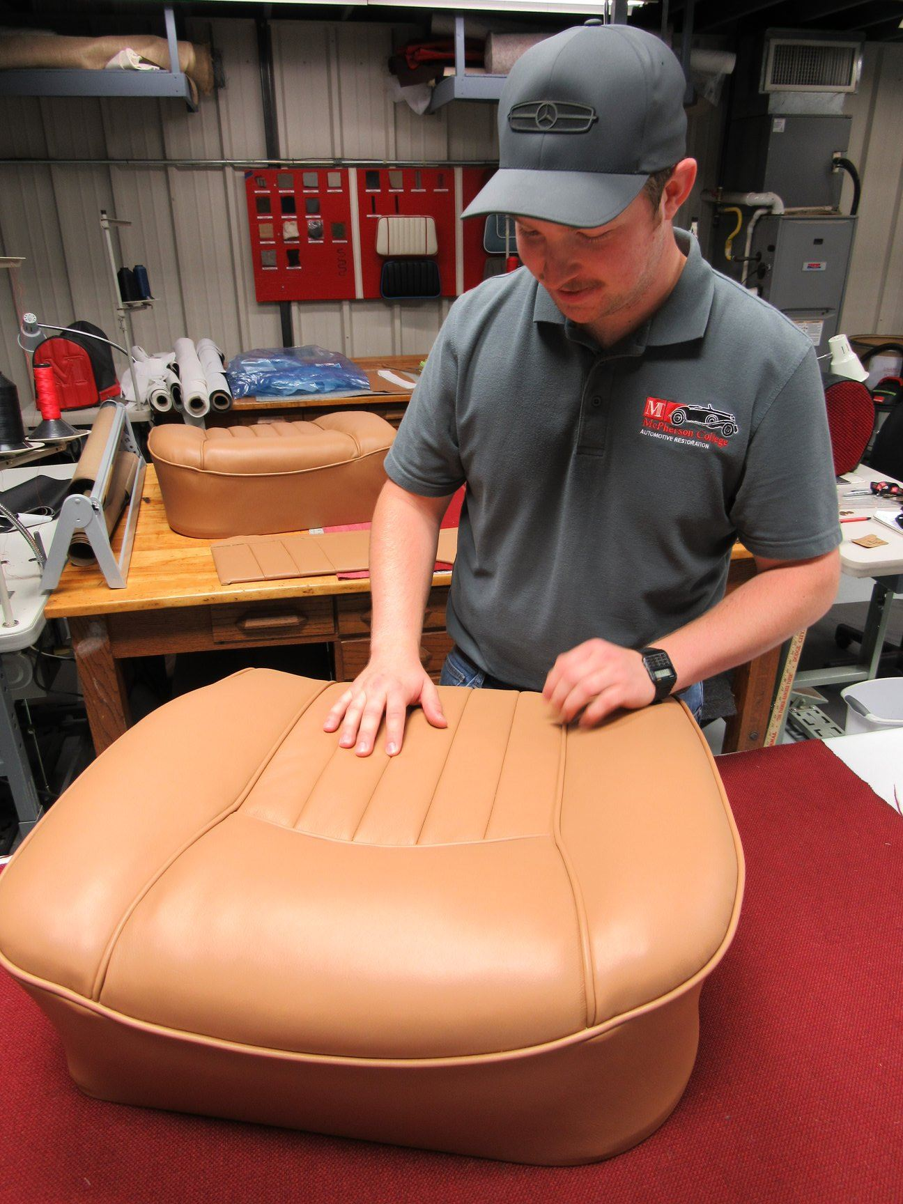 McPherson College Automotive Restoration Student with reupholstered car seat