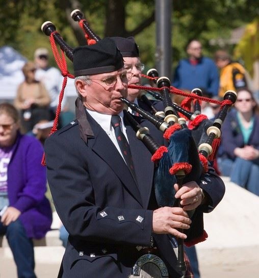 Man playing bagpipes.