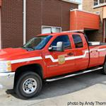 Red and white fire department pickup with Fire Department logo on the side.